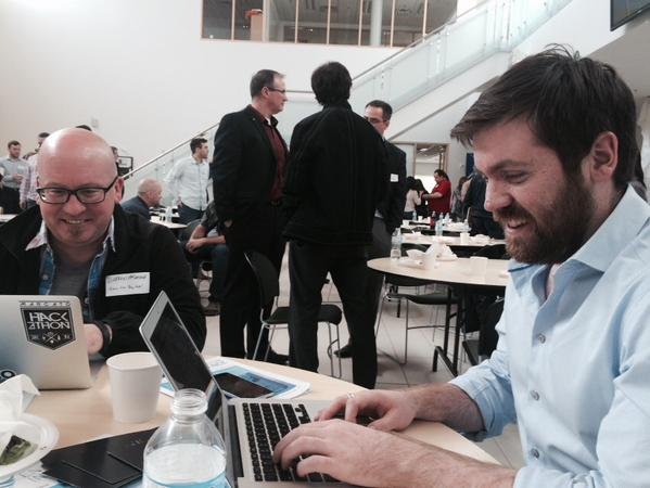 D. Darren MacDonald, left, and A.J. Fraser work on the Slack channel before our luncheon had broken up.
