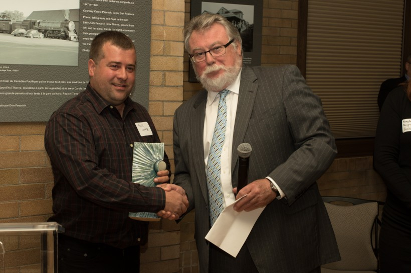 Rock Laforge, left, receives the award from BioNB Chair Greg Kealey. (Photo by John MacDermid, Eh to Zed)